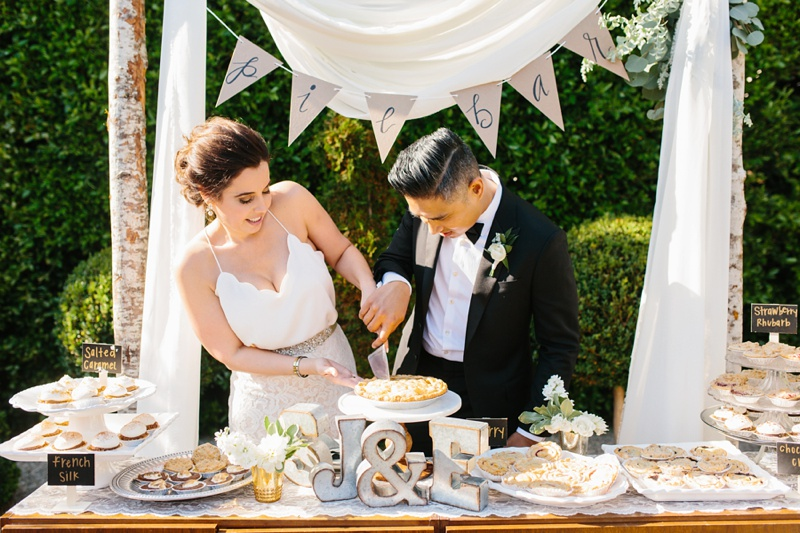 pie cutting wedding dessert table photo